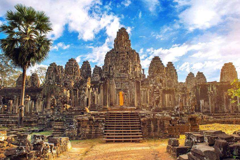 Ancient+stone+faces+at+sunset+of+Bayon+temple,+Angkor+Wat,+Siam+Reap,+Cambodia